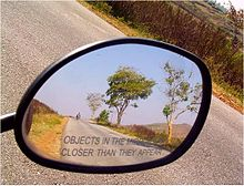 220px-Rear-view-mirror-caption